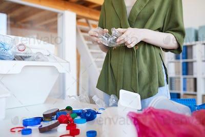 Woman Sorting Plastic at Home