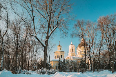 Gomel, Belarus. Winter City Park. Peter And Paul Cathedral In Sunny Winter Day. Famous Local