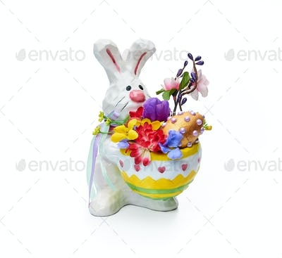 Easter bunny with flower arrangement on a white background
