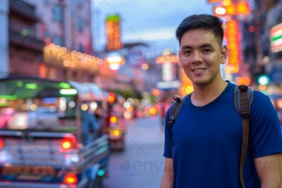 Young Asian tourist man exploring at Chinatown in Bangkok Thailand