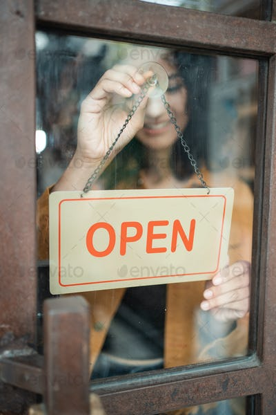 business owner turn the open sign