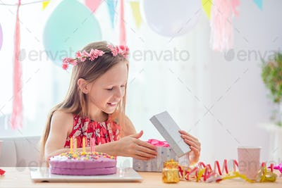 Caucasian girl at birthday. Festive colorful background with balloons. Birthday party and wishes