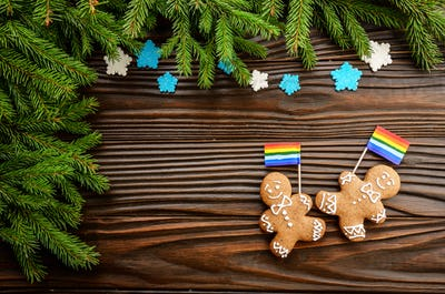 Christmas background of gingerbread man with flag spruce branches