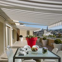 Exterior Shots of a Modern Terrace with Dining Table