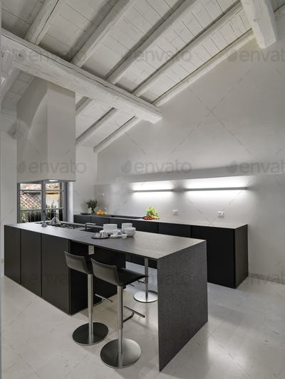 Interiors of the Modern Kitchen in the Attic Room