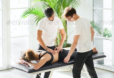 Two osteopaths doing a patient evaluation