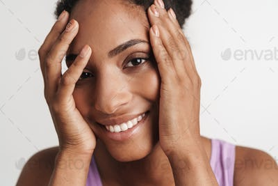 Portrait of african american woman covering her face and smiling