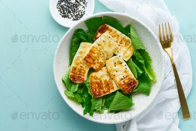 keto ketogenic diet haloumi with lettuce on pastel background closeup copy space top view