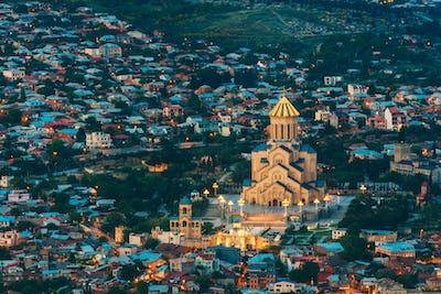 Tbilisi Georgia. Evening Aerial View Of Illuminated Sameba Complex, Holy Trinity Cathedral, Summer