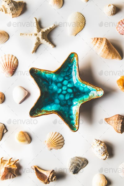 Beautiful plate starfish decoration on white background, top view