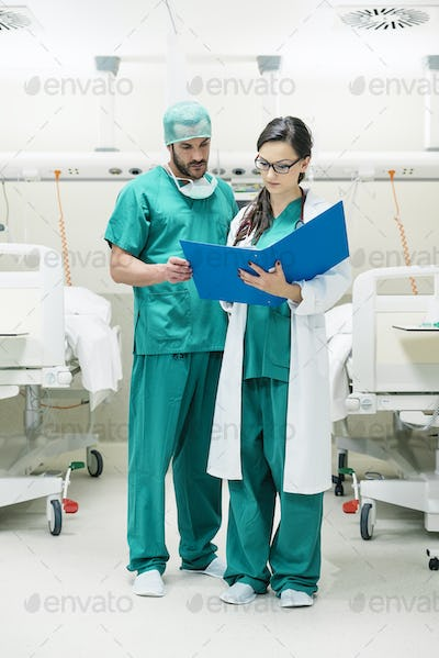 Medical team workers  examining a medical report