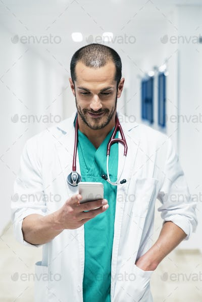 Beautiful doctor writting on cellphone at hospital