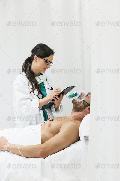 Doctor is caring a sick person