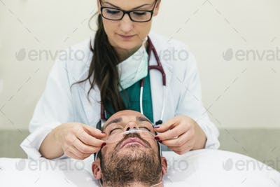 Doctor is caring a sick patient.
