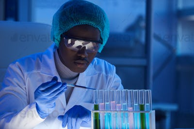 African scientist working with samples