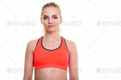 Studio shot of young beautiful teenage girl ready for gym