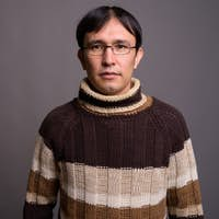 Young Asian nerd man wearing turtleneck sweater against gray bac