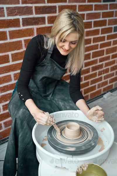 Woman making ceramic pottery