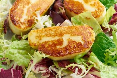 Macro cyprus fried halloumi with healthy salad. Lchf, pegan, fodmap, paleo, scd, keto