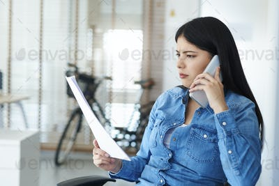 Asian woman discussing problem on the phone