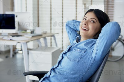 Cheerful woman in the office