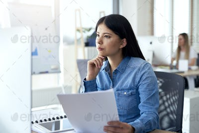 Concentrated Asian woman working in the office