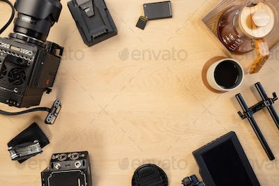 Directly above shot of filming equipment and coffee arranged on table