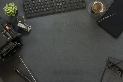 Overhead view of keyboard and diary with photographic equipment on table