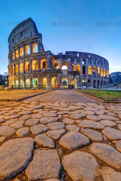 The illuminated Colosseum in Rome at dawn