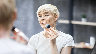 Middle-Aged Lady Applying Face Powder With Cosmetic Brush Indoors, Panorama