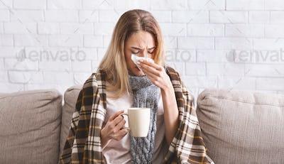 Girl with tea treated at home during coronavirus