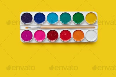 watercolor package on a yellow background