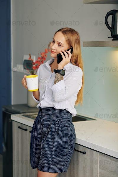 Businesswoman having morning coffee