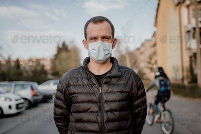 Man Wearing Protective Mask Against Pandemic Coronavirus Covid-19 Sars Epidemic