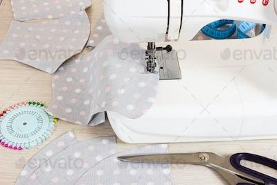 Sewing reusable fabric masks at home for coronavirus protection.
