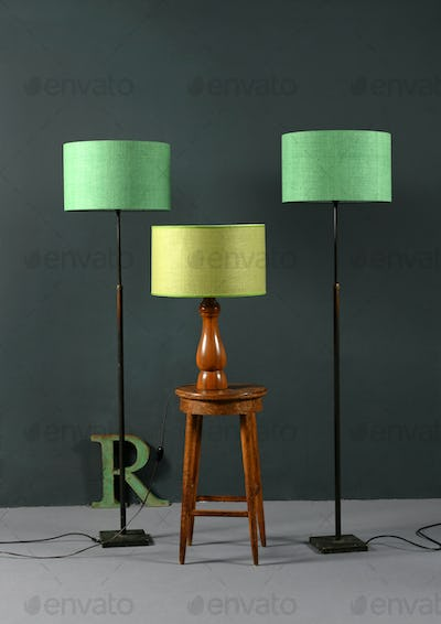 Three vintage lamps with green shades