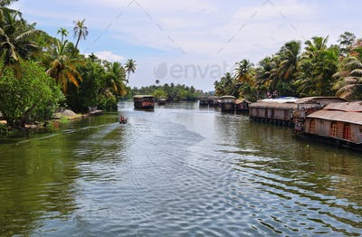 Boathouses sailing in the backwaters in Allepey, Kerala, India.