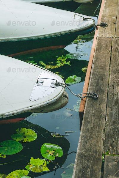 rent rowboat anchored at the pier of a lake in city park. Hamburg
