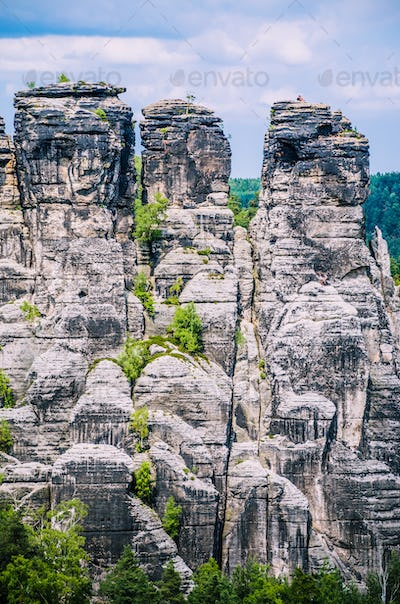 Alpinists on the top of relief camstone stones in Saxony national park, Bastai, Dresden, Germany