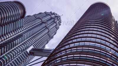 Close up dynamic perspective view from the bottom upwards on Petronas Towers