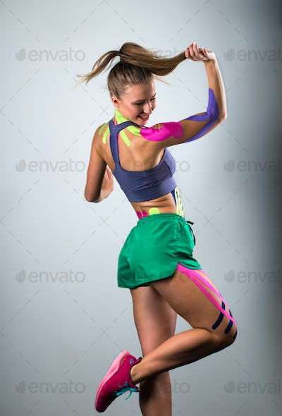 Portrait of a young athletic girl, alternative kinesitherapy