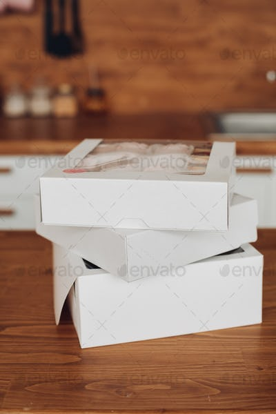 Picture of three white boxes with homemade marshmallows inside