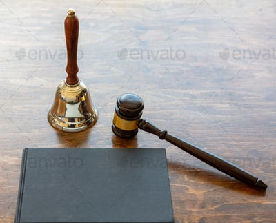 Judge auction gavel and bell on wooden background, copy space.