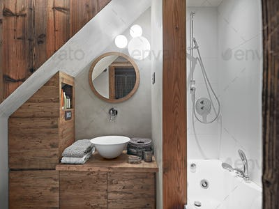 Interiors of the Rustic Bathroom in the Attic Room