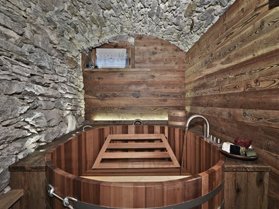 Interiors of a Rustic Bathroom with Stone Walls