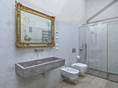 Interiors of a Modern Bathroom in the Attic With Wood Floor