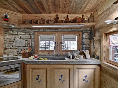 Interior of a Rustic Kitchen with Wooden Beamed Ceiling
