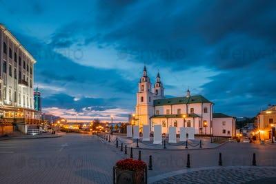 Minsk, Belarus. Illuminated Cathedral Of Holy Spirit In Minsk At Evening Or Night Street Lights