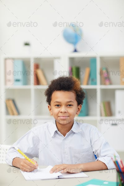 African schoolboy sitting in the classroom