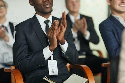 Businessman applauding at seminar